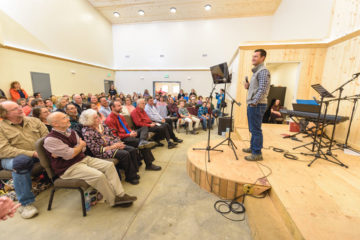Corey Lynch, Director of Alaska Projects, addresses members of the church during a special dedication last week in Dillingham.