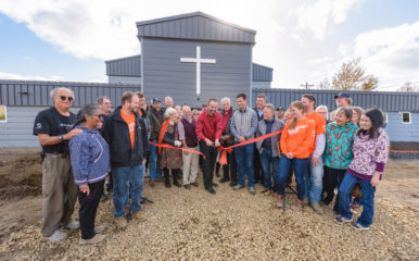 Members of Dillingham Moravian Church and Samaritan's Purse volunteers gathered to celebrate the new building we opened last week.