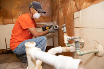 Volunteers must wear masks due to mold in the home.
