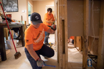 Volunteers remove damaged sheetrock from Joe's home.
