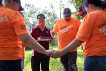 Team Patriot volunteers pray with Joe after their work on his home is done.