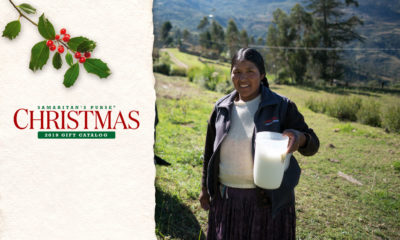 Rosemery holds a container of fresh milk from the dairy cow given to her family by Samaritan's Purse as part of our dairy animals project in Bolivia.