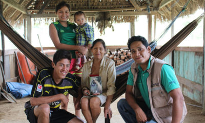 Samaritan's Purse agricultural technician Juan Carlos visits Nolberto's home and talks about God's Word with the family.