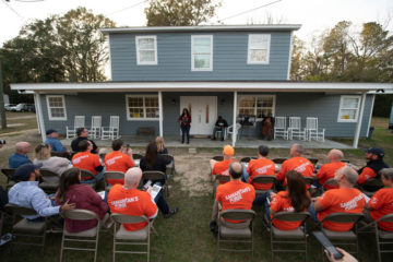 Samaritan's Purse volunteers welcome Miss Angel and her family home after they helped rebuild and repair their house in Chipley, Florida.