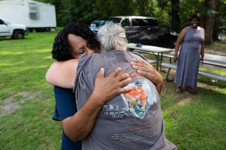 Miss Angel embraces a Samaritan's Purse volunteer working to help her family return home after it was destroyed by Hurricane Michael.