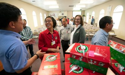 Wen Li and other Operation Christmas Child volunteers help prepare shoeboxes for shipment at Boise Chinese Christian Church in Boise, Idaho.
