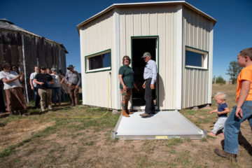 Jana and Tim Ginter officially open the Golden Prairie Shoebox Granary for the packing of Operation Christmas Child shoeboxes.