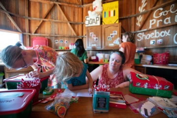 Kids from Golden Prairie Church write personal notes to shoebox recipients.