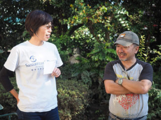 A Samaritan's Purse team member coordinates with a local volunteer.