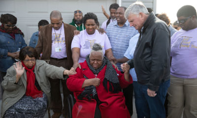 Samaritans' Purse President Franklin Graham prays with Earnestine Reese at her home on Dec. 20.