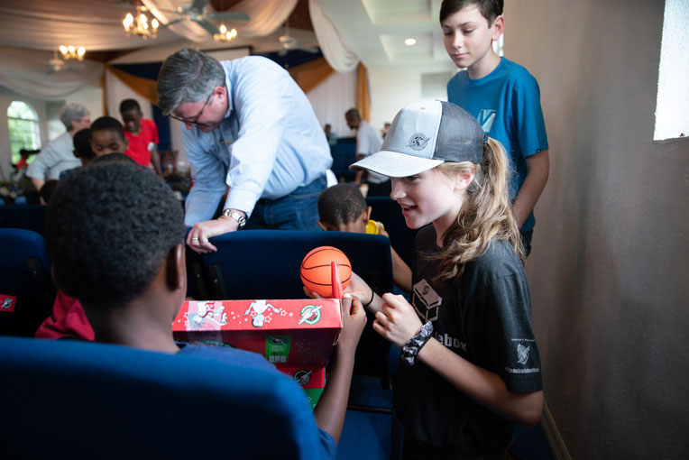 Members of the Graham family took time to bring good news and great joy to children of the Bahamas.