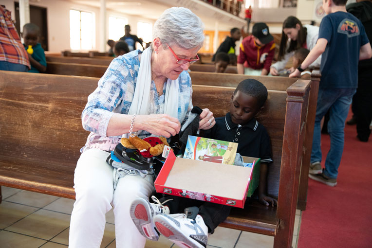 Jane Austin Graham, wife of Franklin Graham, enjoyed helping children with their shoeboxes.