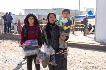The clothes and shoes provided by Samaritan's Purse will help Rona and her two sons weather the winter months.
