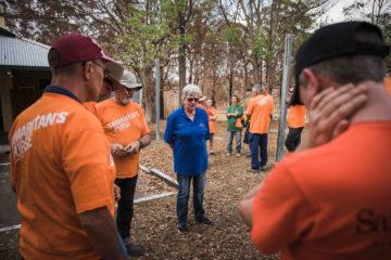 Volunteers and chaplains pray before beginning work.