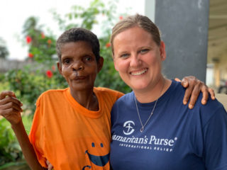 Samaritan's Purse Liberia country director Joni Byker talks with Secoh Mahn as she recovered from her procedure.