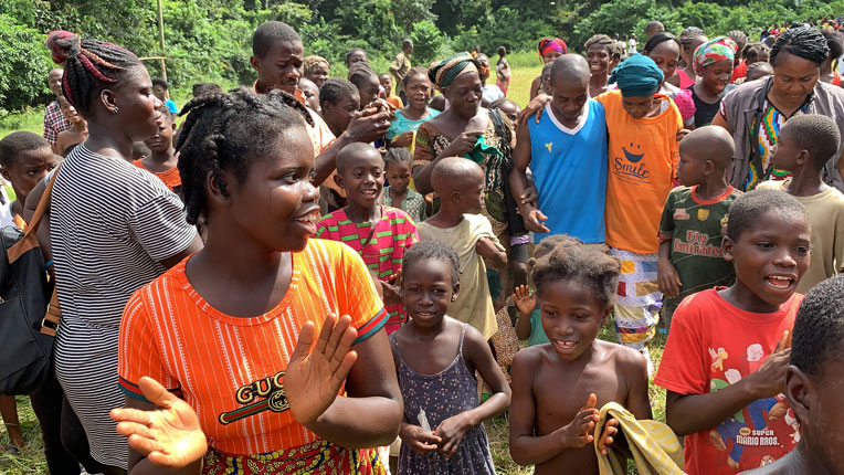 As Secoh returns to her village, the people in her community celebrate her transformation.