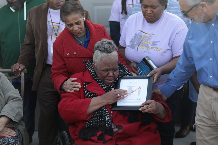 "Earnestine receives a list of costs that are ""Paid in Full"" as she's given a newly-built home."