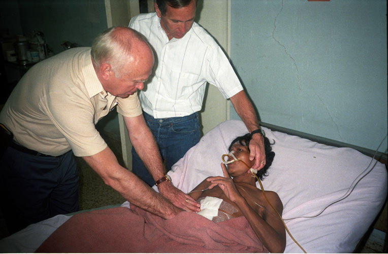 Drs. Lowell (left) and Dick (right) Furman see a patient in Honduras.