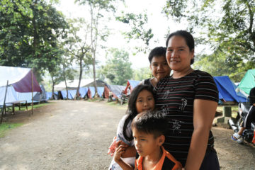 Lalay and her children receive help from Samaritan's Purse at one of the evacuation sites. Her husband is working in Davao in order to earn money for their house repairs.