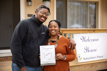 """Kenyatta and her son Nykee celebrate a newly-renovated home """"paid in full"""" by the work and generosity of God's people."""
