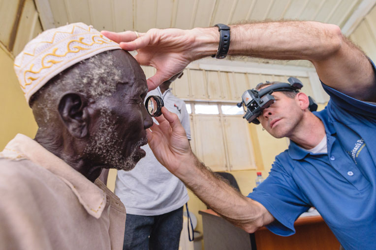 Dr. Ben Roberts examines a patient's eyes to determine if he is a candidate for the surgery.