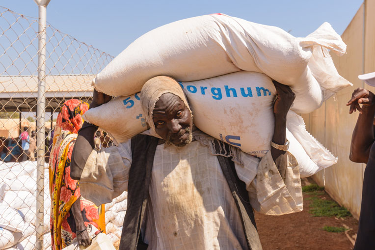 Beneficiaries receive items such as sorghum and lentils.