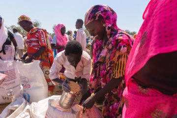 Faiza and her family and neighbors divide up the food rations.