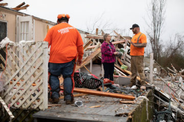 Volunteers encourage Sue in the storm's aftermath.