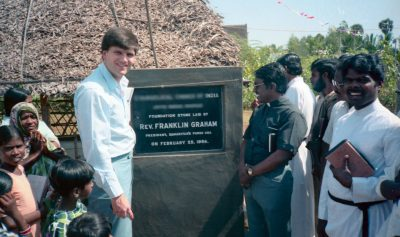 Franklin Graham lays the foundation stone for a church in India in 1984. (Name and location blurred for security.)