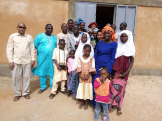 """Members of Alheri Church (translated as """"The Grace of God"""" Church) in Badaguishiri gather outside their new building, one of the latest RECON projects completed in Niger."""