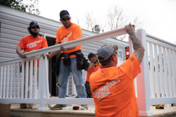 Our Team Patriot volunteers added an accessibility ramp to Chris Holmes' new house.