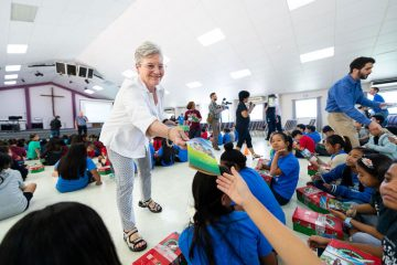 Jane Graham enjoyed visiting with the children of Saipan, the same island where her father fought during World War II when it was occupied by Japan.