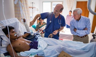 Dr. Stephen Kelley of Memorial Christian Hospital and Dr. Richard Furman meet with a patient in the newly constructed medical facility.