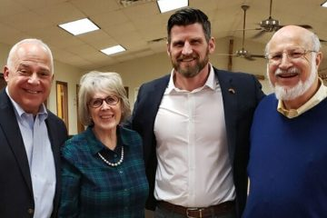 Nancy Benedik and her husband Andy (right) with Jim Harrelson, vice president of Operation Christmas Child (left), and Edward Graham, son of Samaritan's Purse President Franklin Graham.