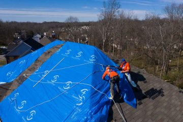 Volunteers are helping homeowners by tarping tornado-damaged roofs.