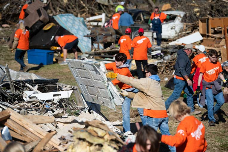 Many volunteers also served in devastated Cookeville, Tennessee, this weekend.