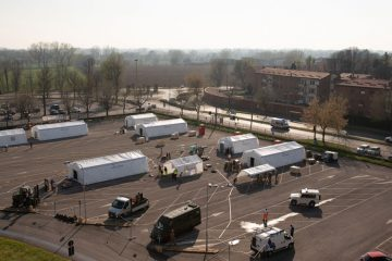 We are setting up our mobile medical facility in the Cremona Hospital parking lot.