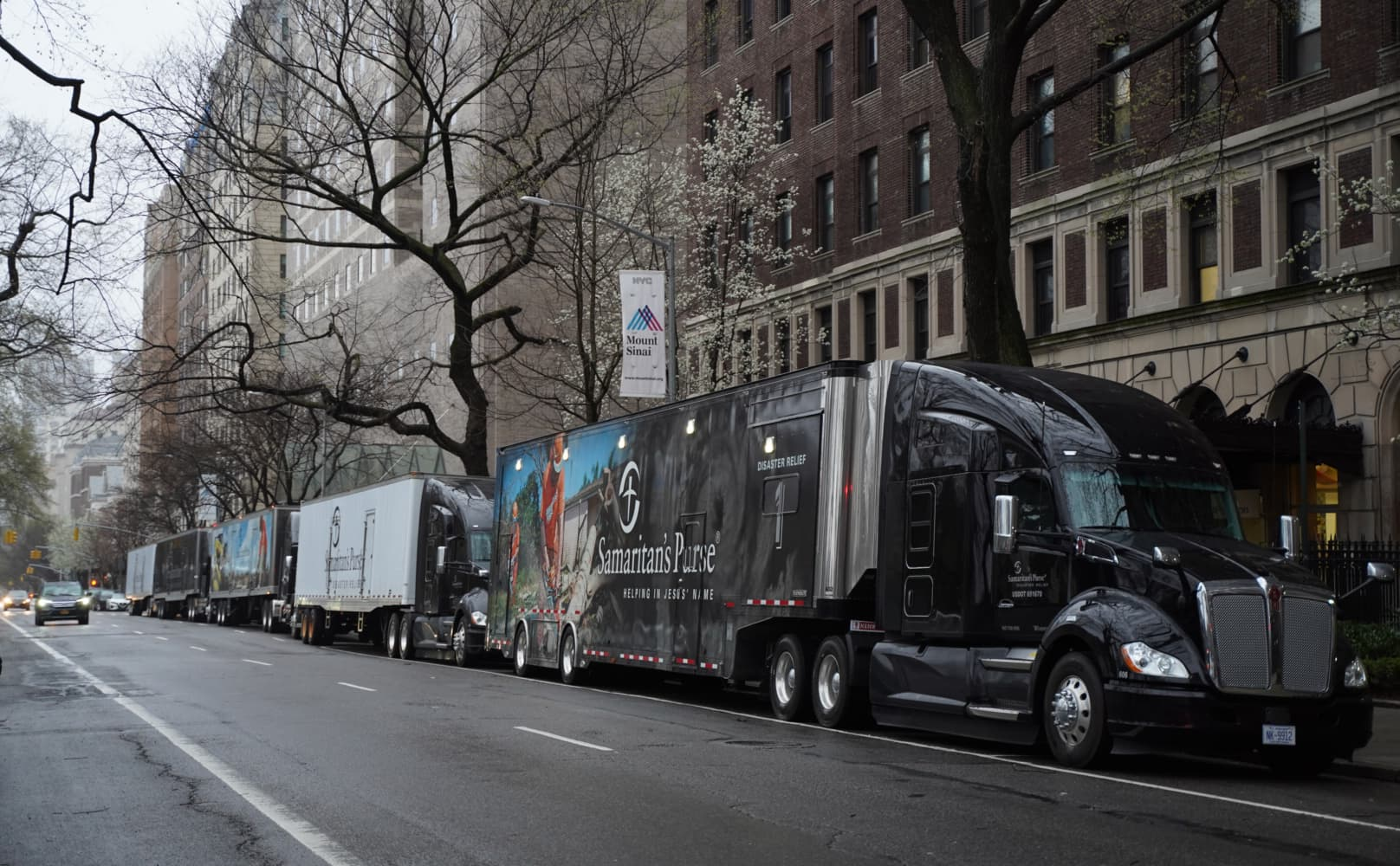Trucks arriving in New York City with the 68-bed respiratory care unit.