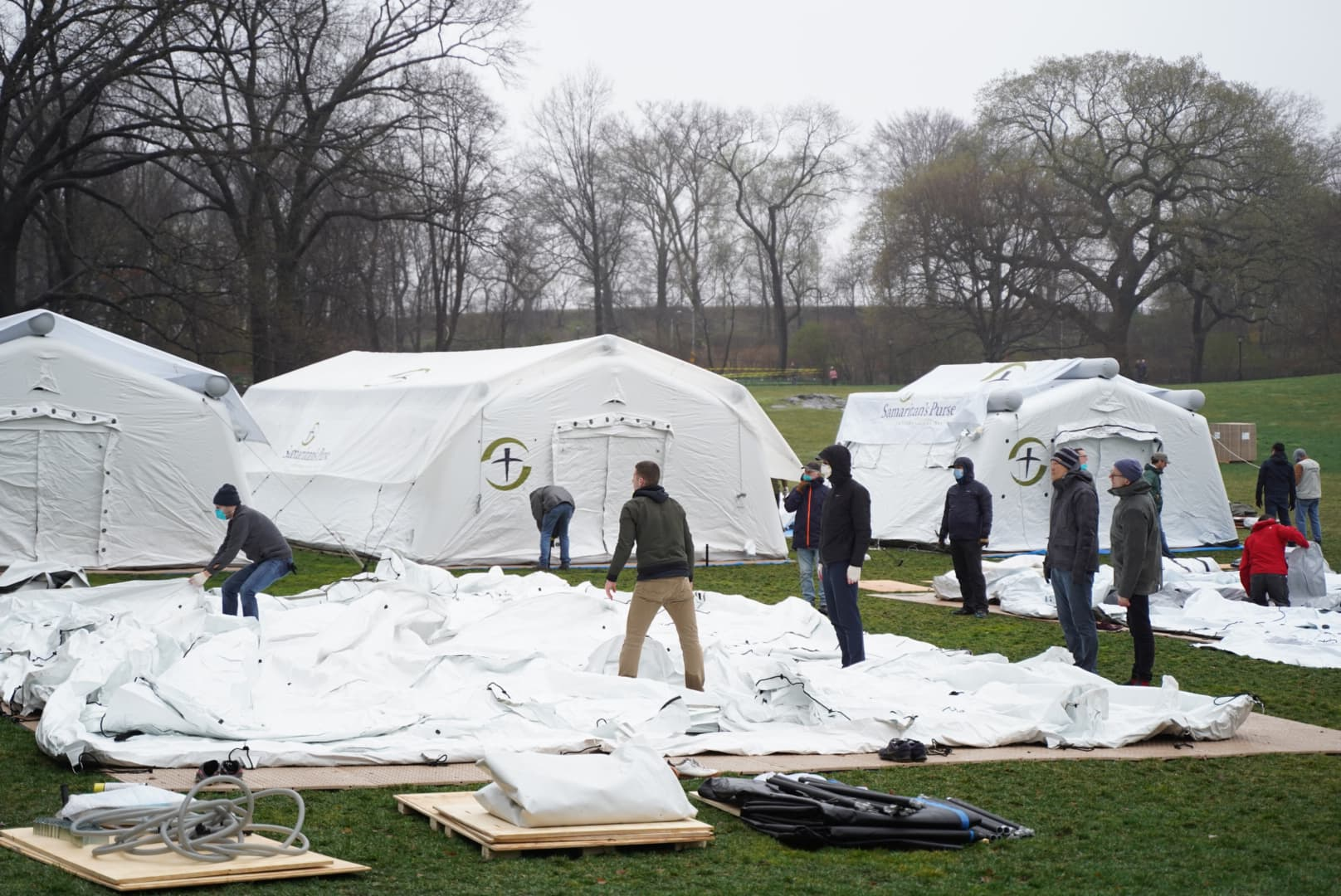 Staff and local volunteers work hard to set up the Emergency Field Hospital in Central Park.