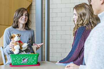 Adrienne talks with students at her university about how packing shoeboxes full of gift items helps children in need across the world in Jesus' Name.