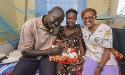 Teresa, Sobit, and nurse Pauline with a healthy baby girl.