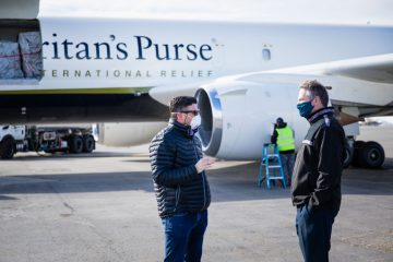 Governor Mike Dunleavy, right, with Edward Graham at the airport in Anchorage.