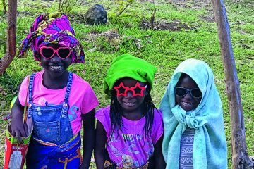 These young patients are thrilled to receive some special sunglasses.