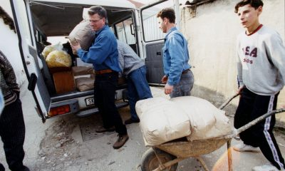 Franklin Graham unloads relief supplies to be distributed among Kosovo refugees.