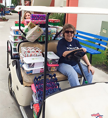 Deborah transports shoebox gifts by golf cart before they go by plane, boat, donkey, or camel to children in need around the world.