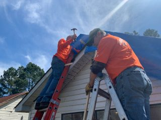 Samaritan's Purse volunteers are busy cleaning up yards and tarping damaged roofs in Jonesboro, Arkansas.
