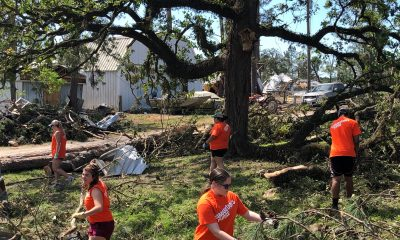 Volunteers clear debris from homes in Polk County, Texas.