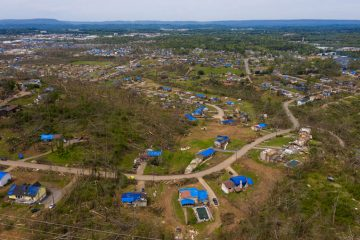 Blue tarps mark damaged homes across Hamilton County, Tennessee, where an EF-3 tornado ripped through late Easter Sunday.