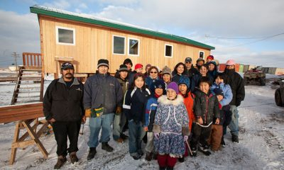 Residents of Hooper Bay, Alaska, celebrate newly-constructed buildings after fire claimed most of the village.