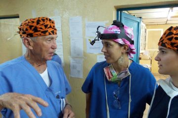 Dr. Richard Furman and his granddaughter visit with former post-resident Dr. Rachel McLaughlin (center). She now serves long-term at Kibuye Hope Hospital in Burundi.